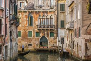 Gondola on canal in Venice, Veneto, Italy by Jon Arnold