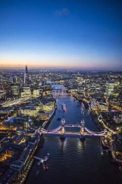 Night Aerial View of the Shard, River Thames, Tower Bridge and City of London, London, England by Jon Arnold