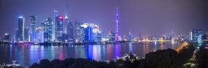 Pudong Skyline across the Huangpu River, the Bund, Shanghai, China by Jon Arnold