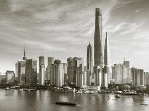 Shanghai Tower and the Pudong Skyline across the Huangpu River, Shanghai, China by Jon Arnold