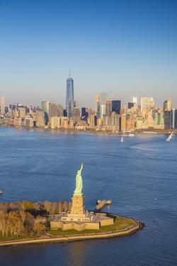 Statue of Liberty and Lower Manhattan, New York City, New York, USA by Jon Arnold