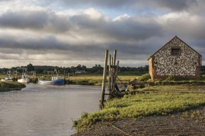 A view of boats moored in the creek at Thornham, Norfolk, England, United Kingdom, Europe