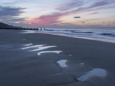 Beautiful sunset colours over the beach at low tide at Mundesley, Norfolk, England, United Kingdom,