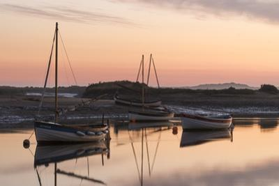 Boats in the channel on a beautiful morning at Burnham Overy Staithe, Norfolk, England, United King