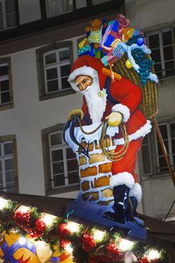 Santa Claus Sign in Christmas Market by Jon Hicks