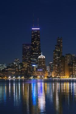 The Chicago Skyline over Lake Michigan at Dusk by Jon Hicks