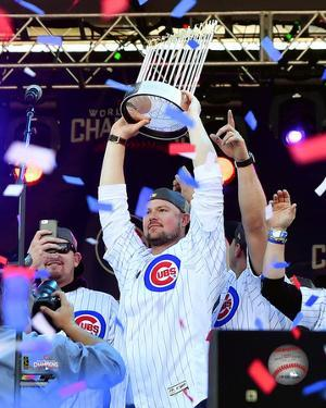 Jon Lester holds World Series Championship Trophy at victory parade 11/4/16, Grant Park in Chicago