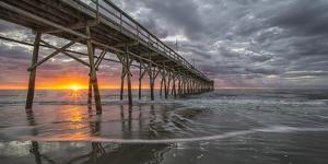 Beach, ocean, waves and pier at sunrise, Sunset Beach, North Carolina, United States of America, No by Jon Reaves