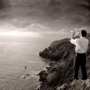 Man Looking Through Telescope at Horizon by Jon Riley