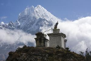 A Buddhist Stupa with Clouds and Himalaya Mountains Towering in Back by Jonathan Irish