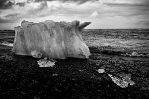 A Small Iceberg on a Volcanic Rock Beach at Jokulsarlon Lake, a Glacial Lagoon by Jonathan Irish