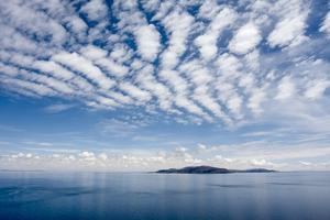 Clouds over Lake Titicaca and Taquile Island, in the Distance by Jonathan Irish