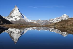Early Morning Sunlight on the Matterhorn, Reflected in Riffelsee Lake by Jonathan Irish
