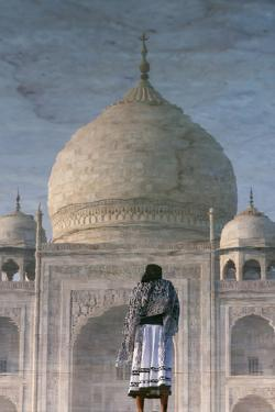 Flipped Image of the Reflection of a Tourist and Taj Mahal in Water by Jonathan Irish