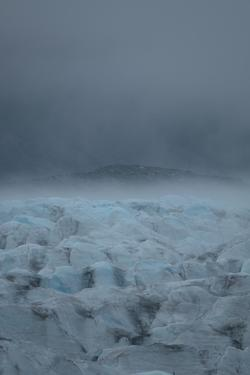 Fog over Bear Glacier in Kenai Fjord National Park. by Jonathan Irish