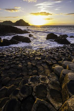 Giant's Causeway Lies at the Foot of Basalt Cliffs on the Edge of the Antrim Plateau by Jonathan Irish