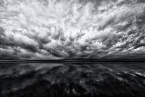Heavy Dramatic Clouds and Their Reflection in Calm Water by Jonathan Irish
