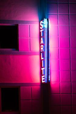 The neon lit sign of the Starlite Hotel in the Art Deco District of South Beach, Miami. by Jonathan Irish
