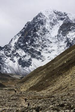 Trekkers Hiking Along the Route to Everest with Lobuche Behind by Jonathan Irish