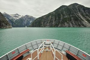 A Boat in the Aqua Green Waters of Tracy Arm Fjord by Jonathan Kingston