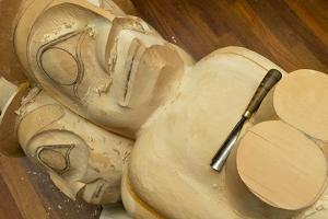 A Chisel Rests on an Unfinished Totem Pole in a Carving Studio by Jonathan Kingston