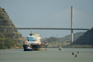 A Large Cargo Ship Sails under the Centennial Bridge in the Panama Canal, Panama by Jonathan Kingston