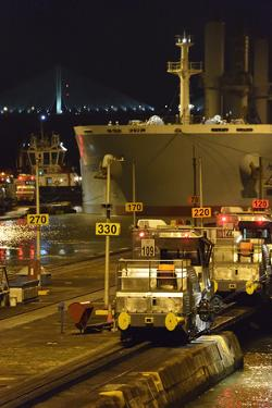 A Massive Panamax Ship Enters the Pedro Miguel Locks in the Panama Canal at Night by Jonathan Kingston