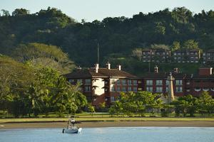 A Recreational Fishing Boat at Anchor in Front of the Upscale Resort of Herradura by Jonathan Kingston