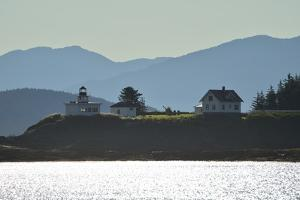 A Scenic View of the Point Retreat Lighthouse and Mountains Near By by Jonathan Kingston