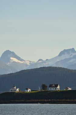 A Scenic View of the Point Retreat Lighthouse and Snow-Capped Mountains Near By by Jonathan Kingston