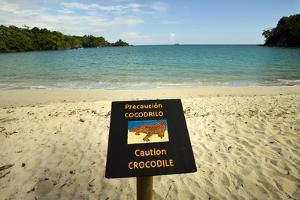 A Sign Warns People from Swimming in the Waters of Playa Manuel Antonio by Jonathan Kingston