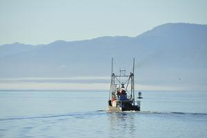 A Small Commercial Fishing Vessel Leaving the Harbor at Prince Rupert by Jonathan Kingston
