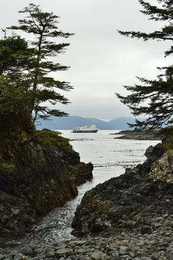A Small Cruise Ship Anchored Off the Coast of Sgang Gwaay by Jonathan Kingston