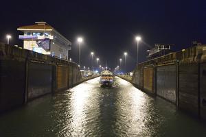 A Small Passenger Ship Enters the Gatun Locks at Night, on the Panama Canal by Jonathan Kingston