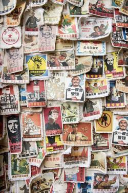 A Wall of Cloth Patches with Political Slogans on Them, Yangshuo, China by Jonathan Kingston