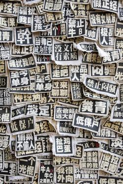 A Wall of Cloth Patches with Political Slogans Written in Chinese by Jonathan Kingston