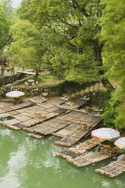 Bamboo Rafts Dock by Stone Stairs on the Li River Near Yangshuo, China by Jonathan Kingston