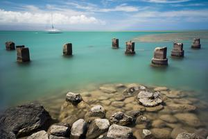 Concrete Pylons of an Old Wharf Stand Sentinel in the Turquoise Kalohi Channel by Jonathan Kingston
