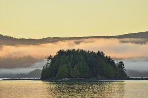 Dawn's Light Illuminates the Bay in Front of Queen Charlotte City by Jonathan Kingston