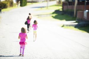 High Key Shot of Children in Pink Tutus Walking Down a Street in Alert Bay, British Columbia by Jonathan Kingston