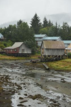 Houses Built on Stilts to Keep Them Above the High Tide Line by Jonathan Kingston