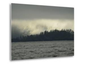 Low Clouds over a Forested Rocky Shore on Sgang Gwaay, or Anthony Island by Jonathan Kingston