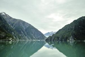 Magnificent Cliffs Reflect in the Aqua Green Waters of Tracy Arm Fjord by Jonathan Kingston