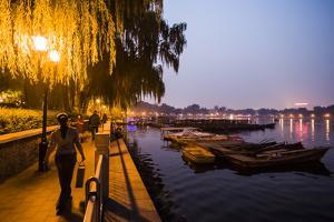People Enjoy the Night Next to Houhai Lake by Jonathan Kingston