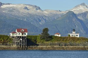 Point Retreat Lighthouse with a Snow-Capped Mountains Looming in the Near Distance by Jonathan Kingston