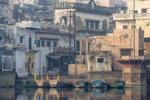 Rowboats Moored at the Ghats of Mathura, India, on the Holy Yamuna River by Jonathan Kingston