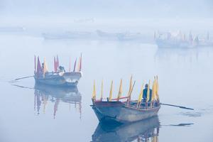 Rowboats with Colorful Flags in Fog at Sunrise on the Yamuna River by Jonathan Kingston