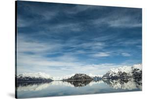 Snow Capped Mountains Rise Out of the Tidewater Bay of Glacier Bay by Jonathan Kingston