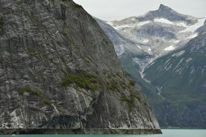 Steep Glacially Polished Cliffs Rise from the Waters of Tracy Arm Fjord by Jonathan Kingston