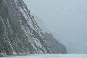 Steep Rain-Soaked Cliffs Rise Out of the Waters Tracey Arm Fjord by Jonathan Kingston